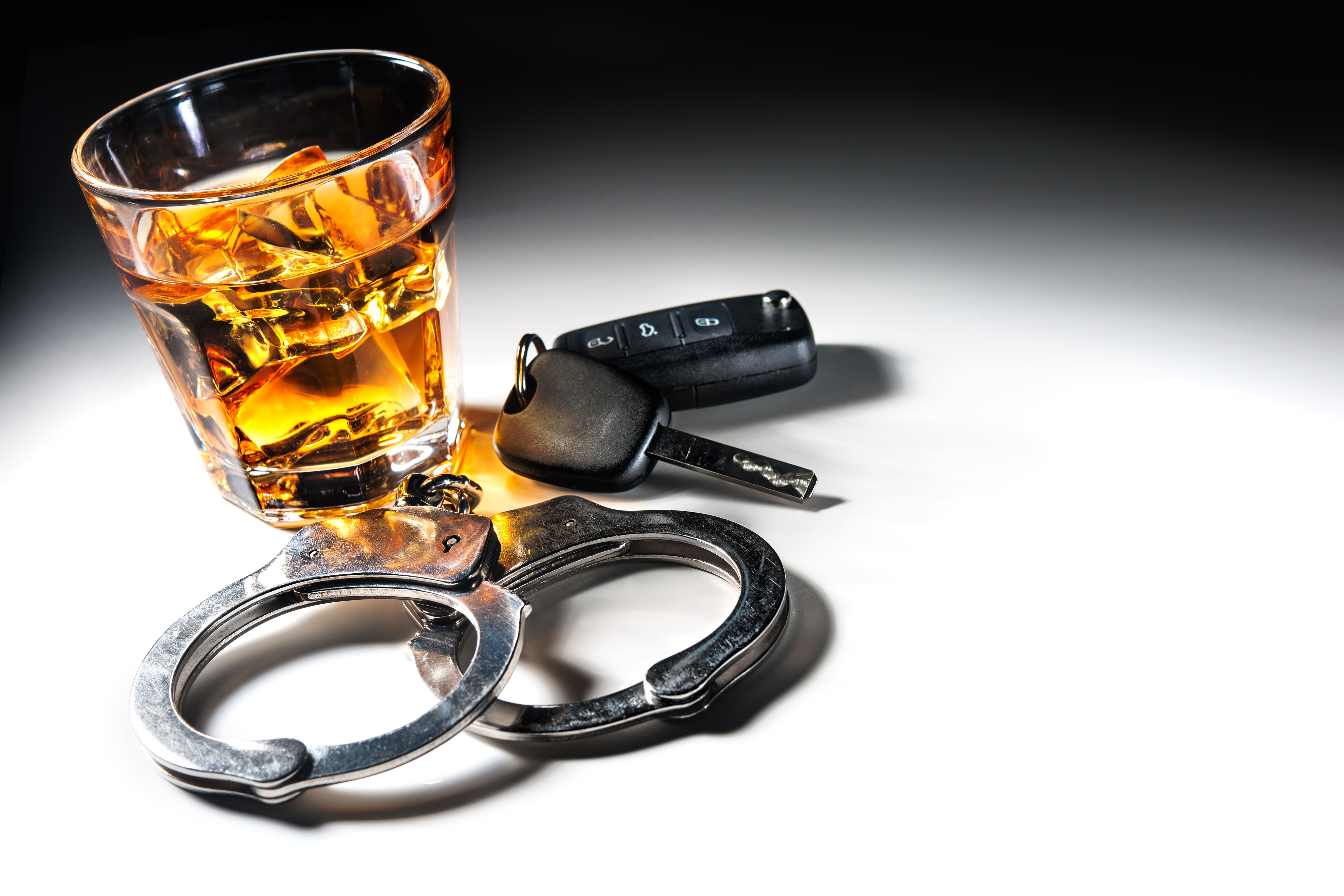 Alcohol, handcuffs and car keys - DUI in Alaska